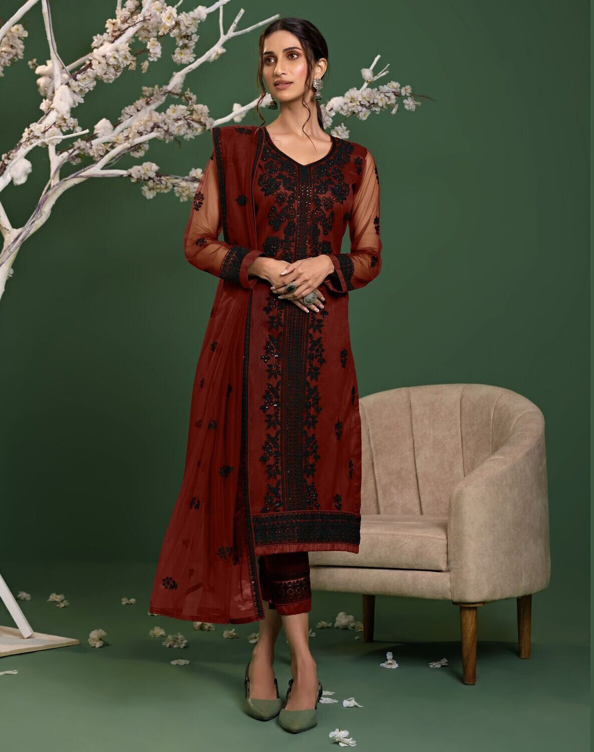 Sequence Embroidered Net Pakistani Suit In Maroon