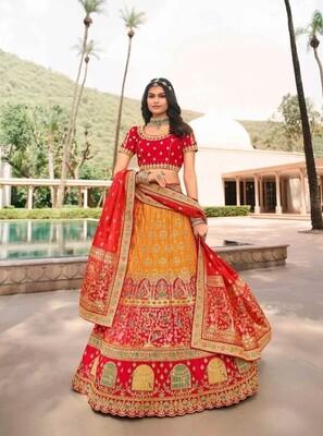 Festive Wear Stone Embroidered Banarasi Silk Lehenga Choli In Mustard Yellow And Red