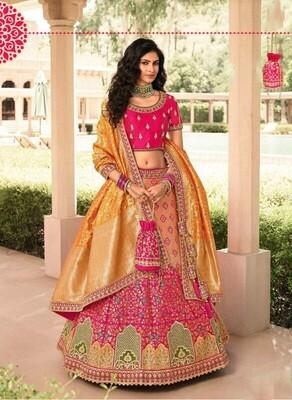 Bridal Wear Stone Embroidered Banarasi Silk Lehenga Choli In Rani Yellow