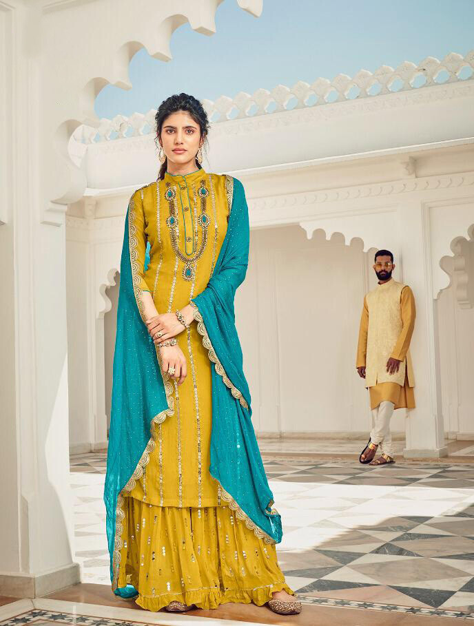 Party Wear Teal Blue Yellow Plazzo Suit In Faux Georgette With Heavy Embroidery