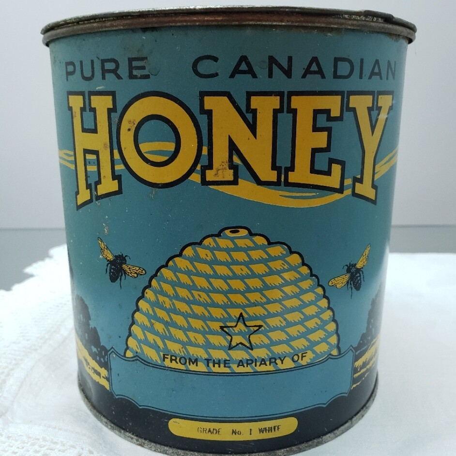 Pure Canadian Honey - tin container -  Booth V94