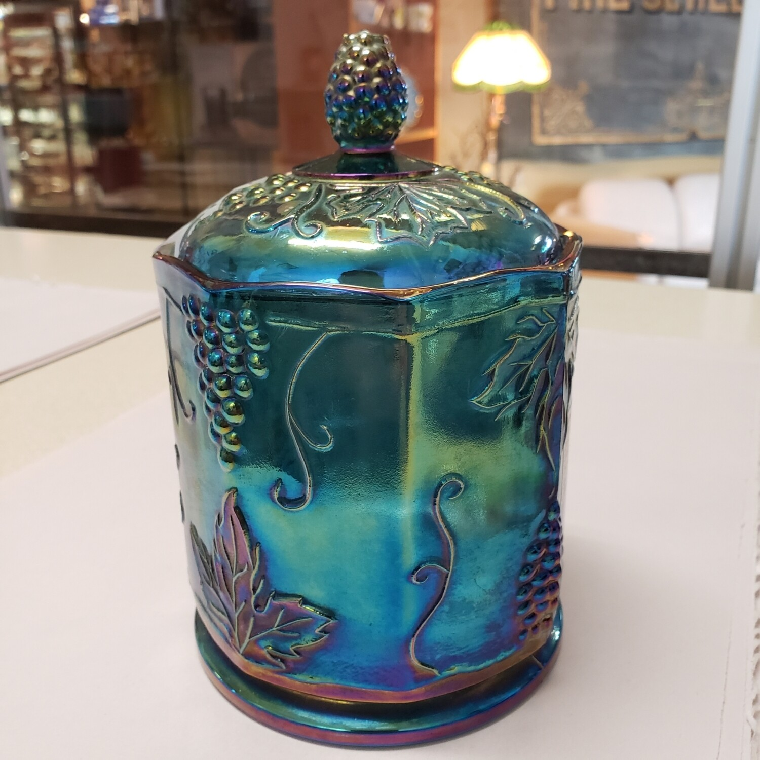 Iridescent glass canister with lid