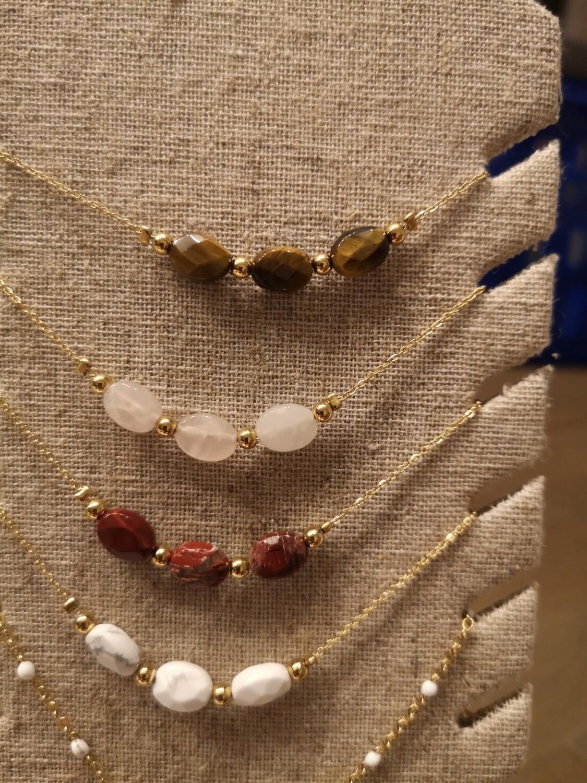 Bracelet acier doré perles bordeaux