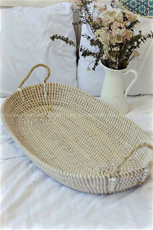 Oval white seagrass baby basket with handle