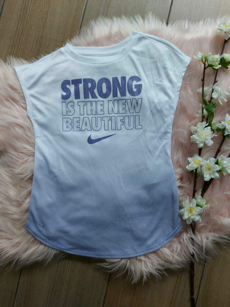 Camiseta deportiva lila Strong is the New beautiful, Nike  , 5-6 años