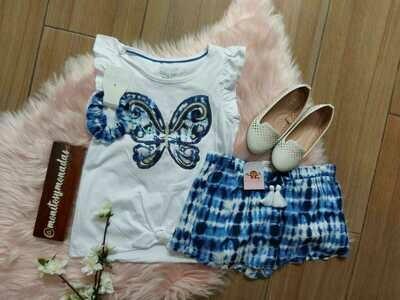 Set blusa mariposa + short azul + moño. 7/8 años