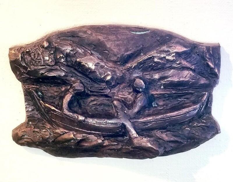 Bronserelief av oselvar med par
