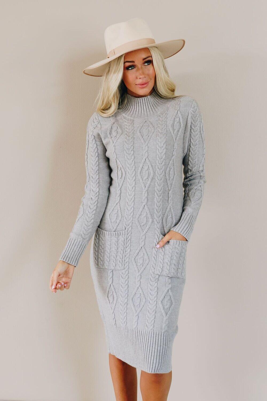 Women Falling into Fall Sweater Dress