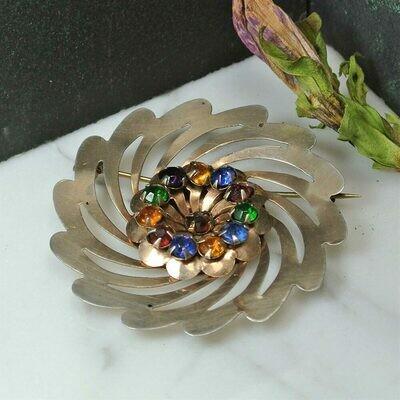 Серебряная брошь с позолотой и кристаллами