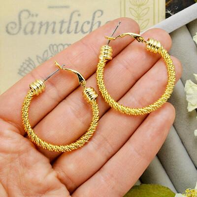 Золотистые плетёные серьги