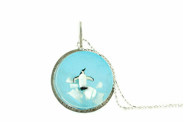 Small penguin disk necklace