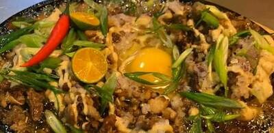 Sisig Sizzler with Egg