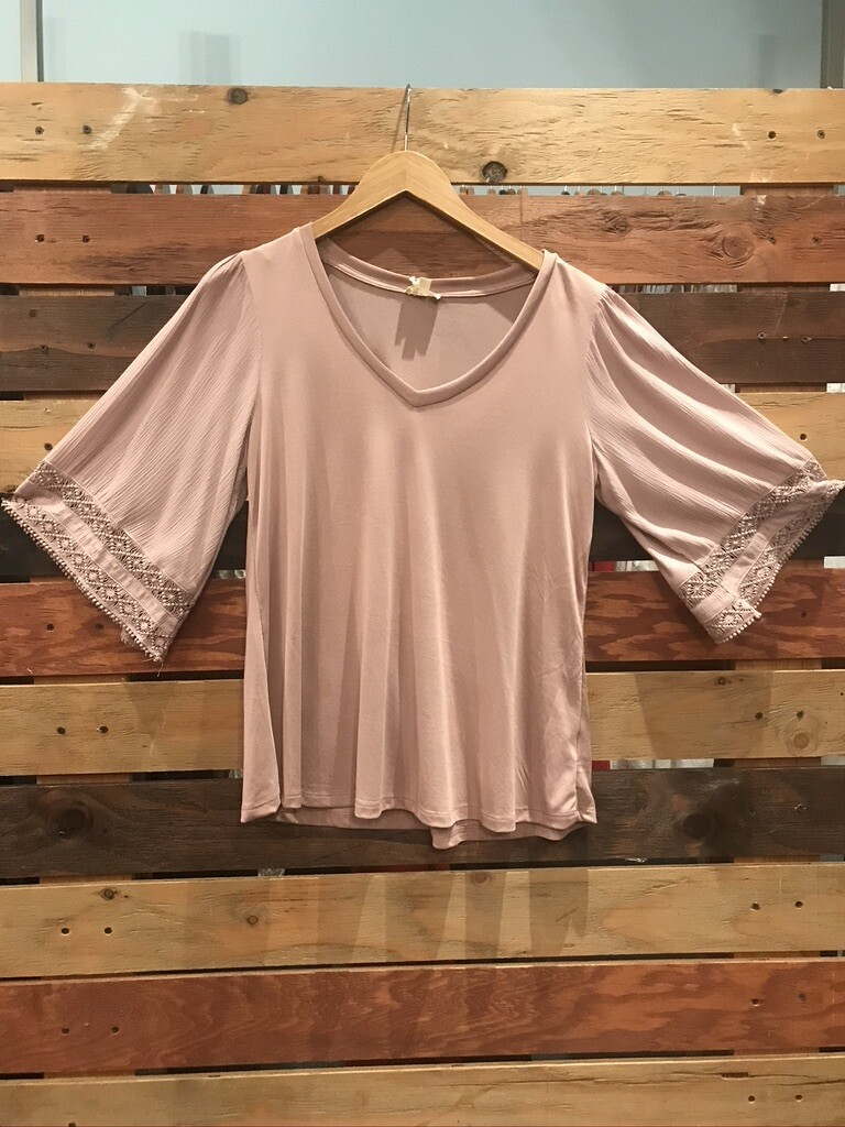 Mauve top with decorative bell sleeves