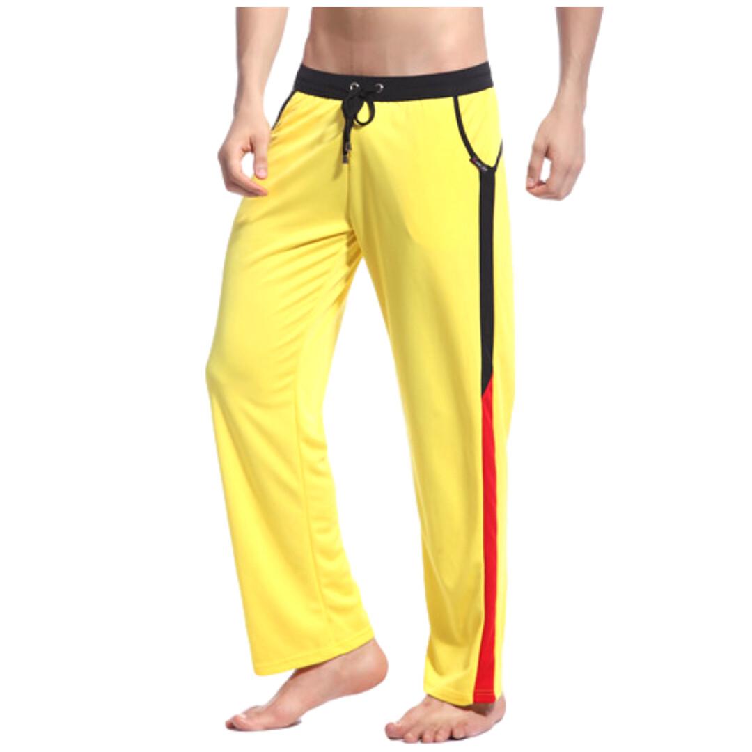 Pantalón deportivo, modelo CKU color amarillo