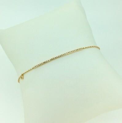 Pulsera de oro amarillo Con pave de diamantes talla brillante, con un peso de 0,10 ktes