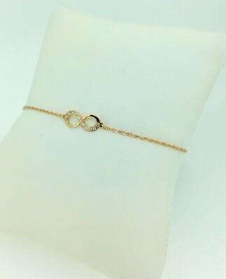 Pulsera de oro amarillo y diamantes talla brillante con el signo de infinito, 0,05ktes