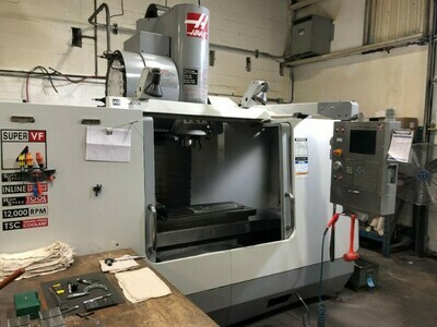 1 - USED HAAS VF4SS 4TH AND 5TH AXIS VERTICAL CNC MACHINING CENTER