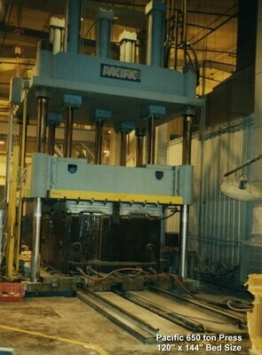 1 - USED 690 TON PACIFIC 4-POST DOWN ACTING HYDRAULIC PRESS