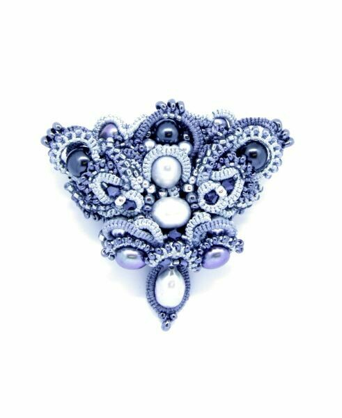 This designer brooch with pearls