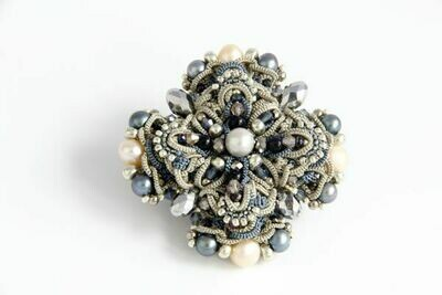 Lacy brooch