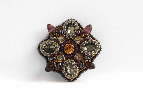 The brooch-medal with crystals
