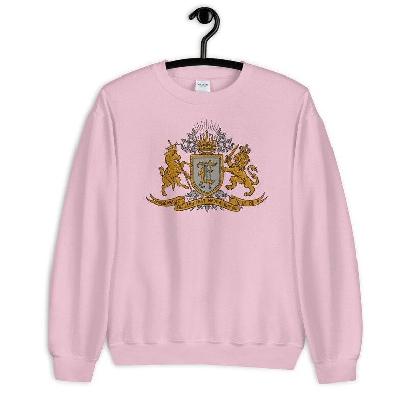 """""""Music Was The Lamb That Made A Lion Out Of Me"""" Coat of Arms Sweatshirt Pink"""
