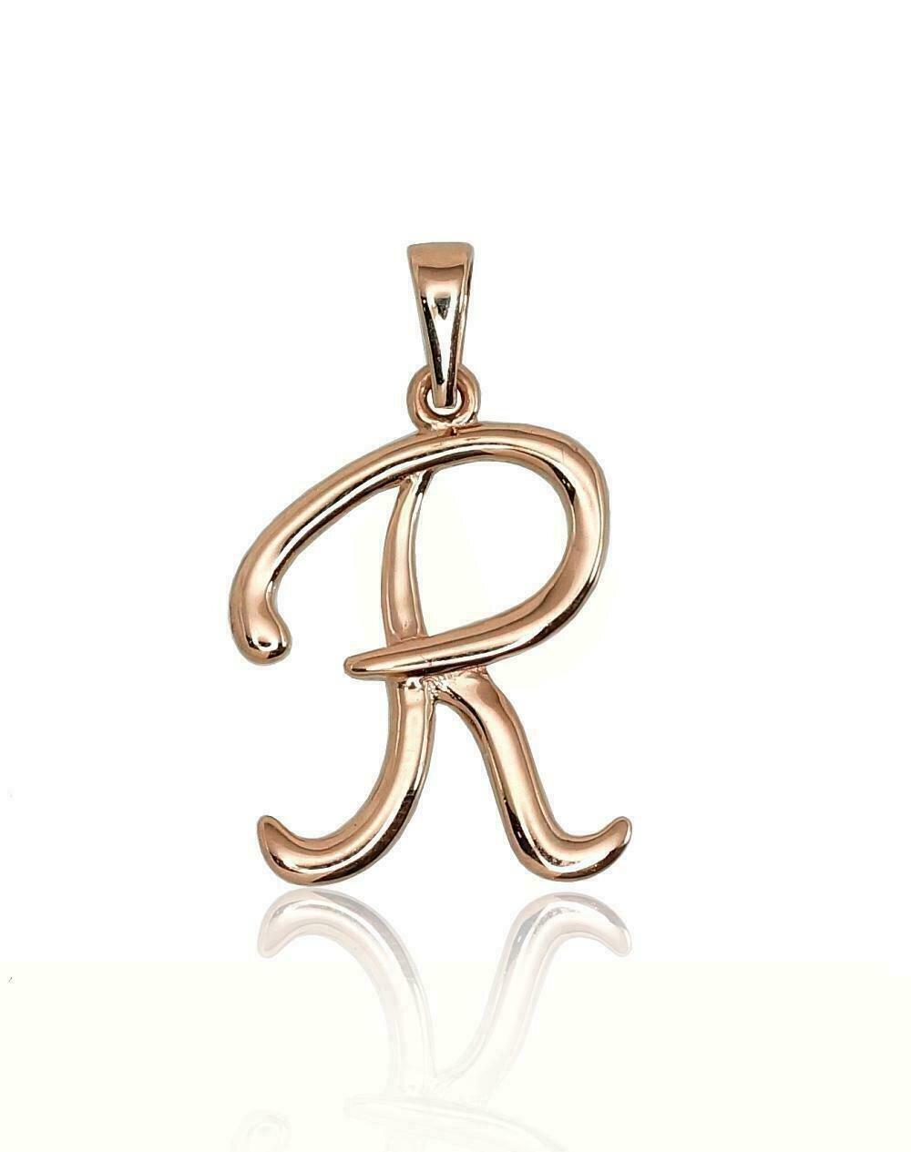 Auksinis pakabukas, Raidė R