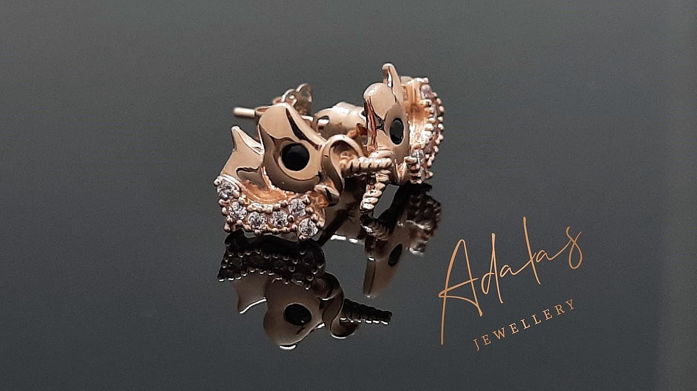 Auksiniai auskarai, vienaragis