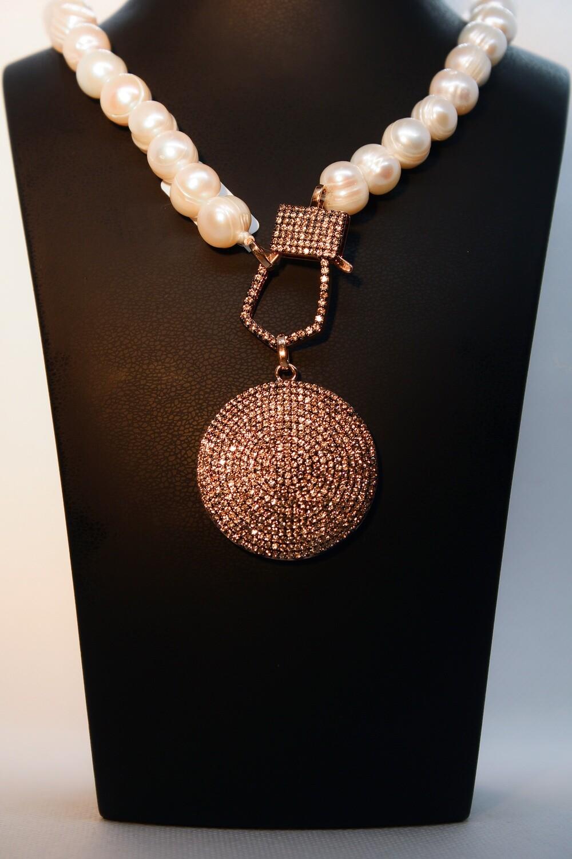 Collana di perle con pendente champagne