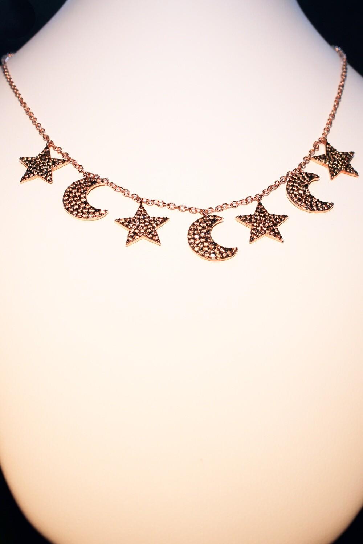 Collana rosè con stelle e lune champagne