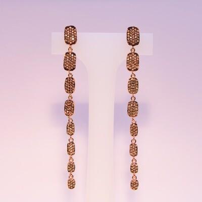 Orecchini pendenti lunghi rosè con zirconi champagne
