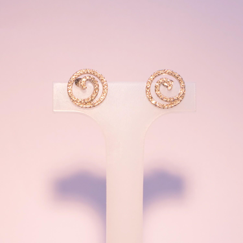 Orecchini in argento a spirale con zirconi