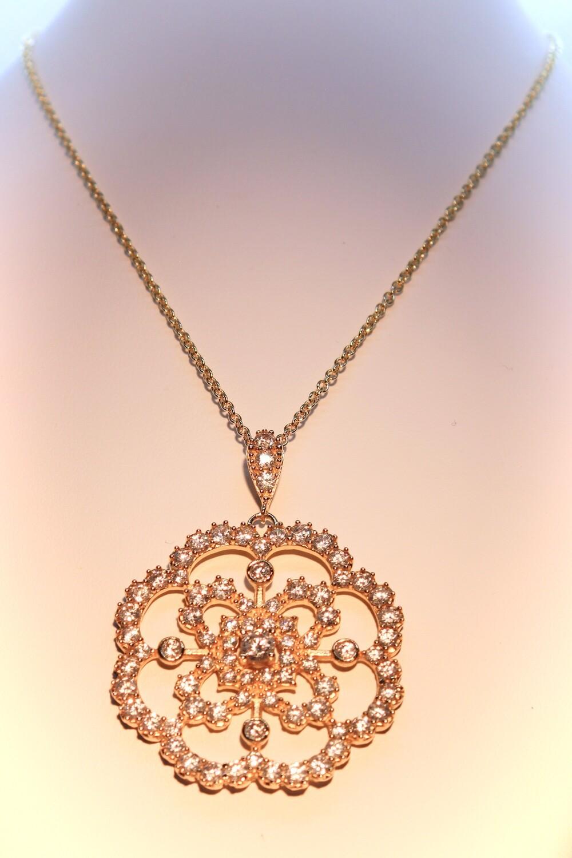 Collana in argento dorato con zirconi