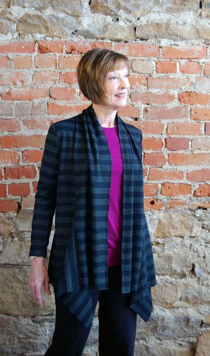 Ann's Cardigan in a black and grey stripe knit.