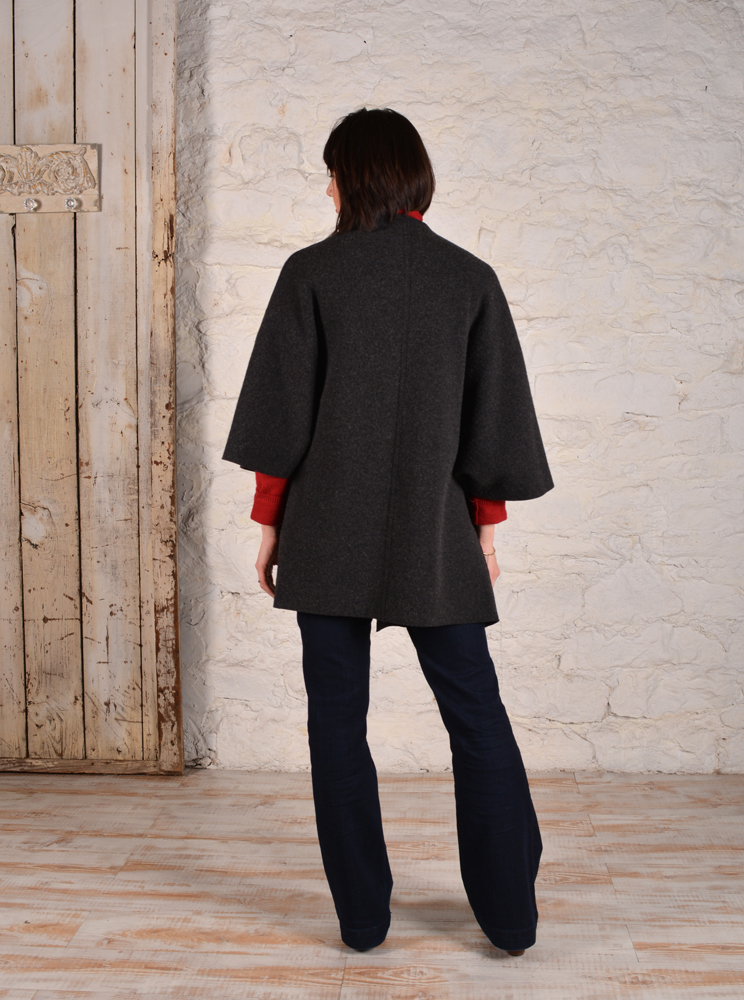 Back view of chateau coat made in charcoal grey boucle material