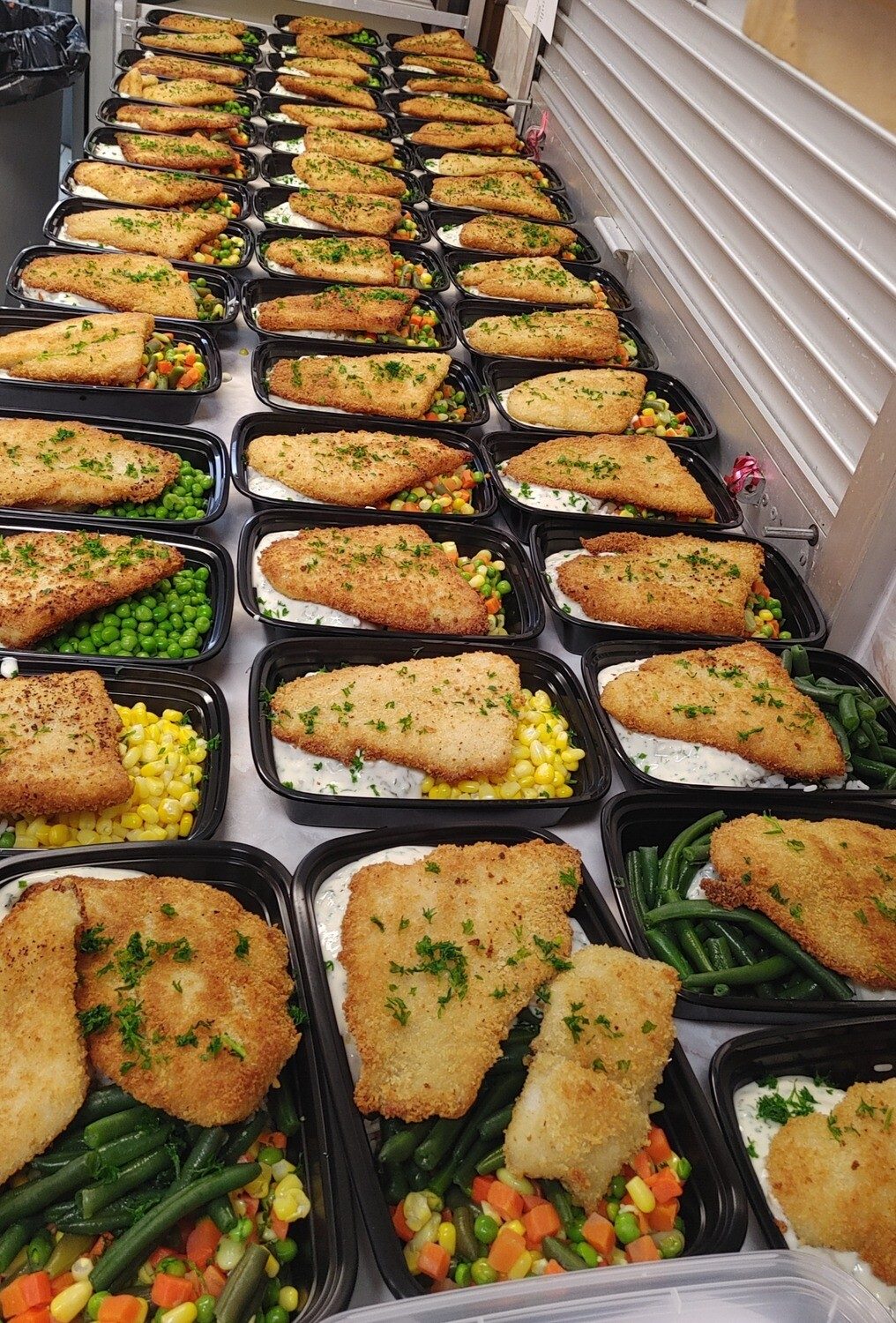 Breaded Basa Fillet with Rice Medley, Vegetables & Parsley Sauce