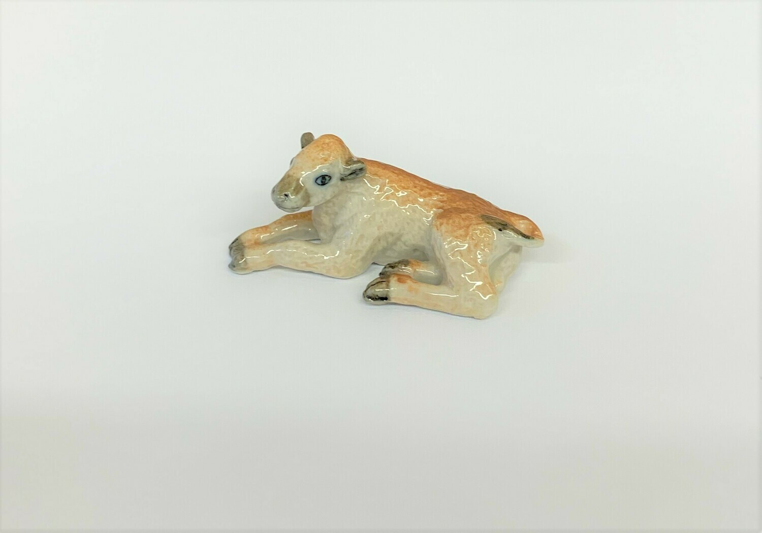 Bison Calf Laying Down Figurine