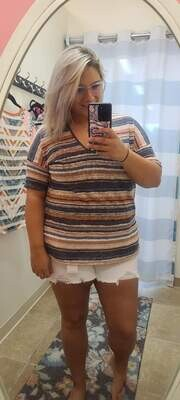 Striped top with boat neck