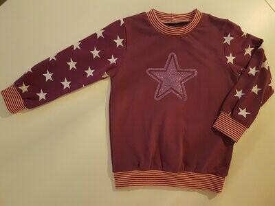Lilla genser med stjerne str. 104