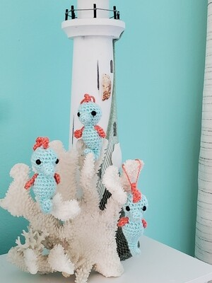 coral and blue sea horses