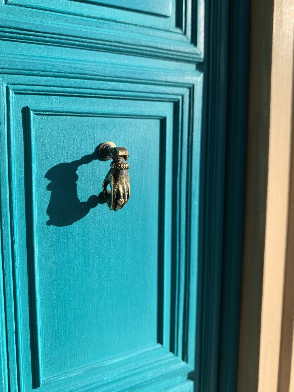 French hand shaped door knocker