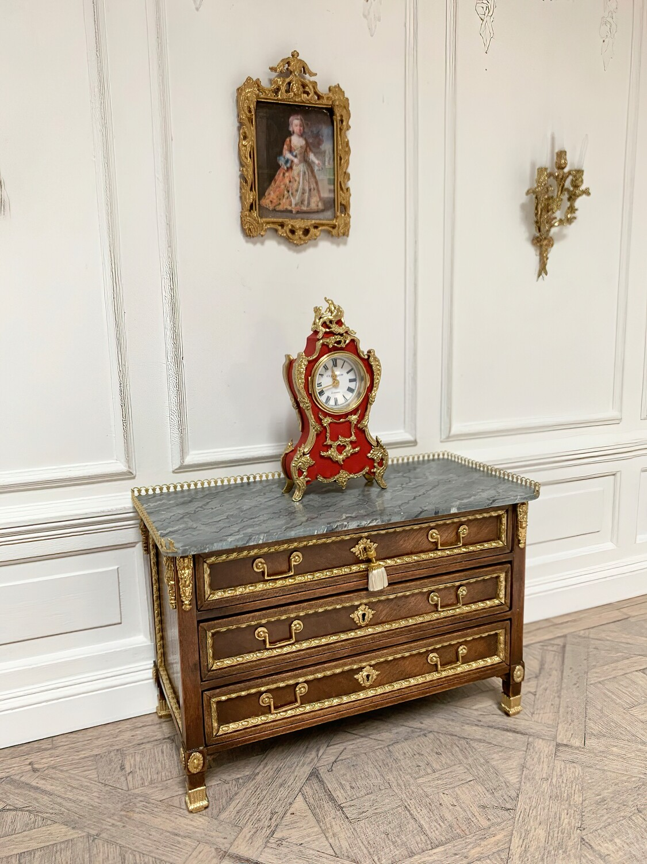 French Ormolu mantel clock in red