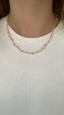 Collana bianca e dorata