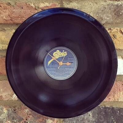 "Stretched 12"" Vinyl LP Clock - 'Teach the World to Laugh - The Barron Knights'."