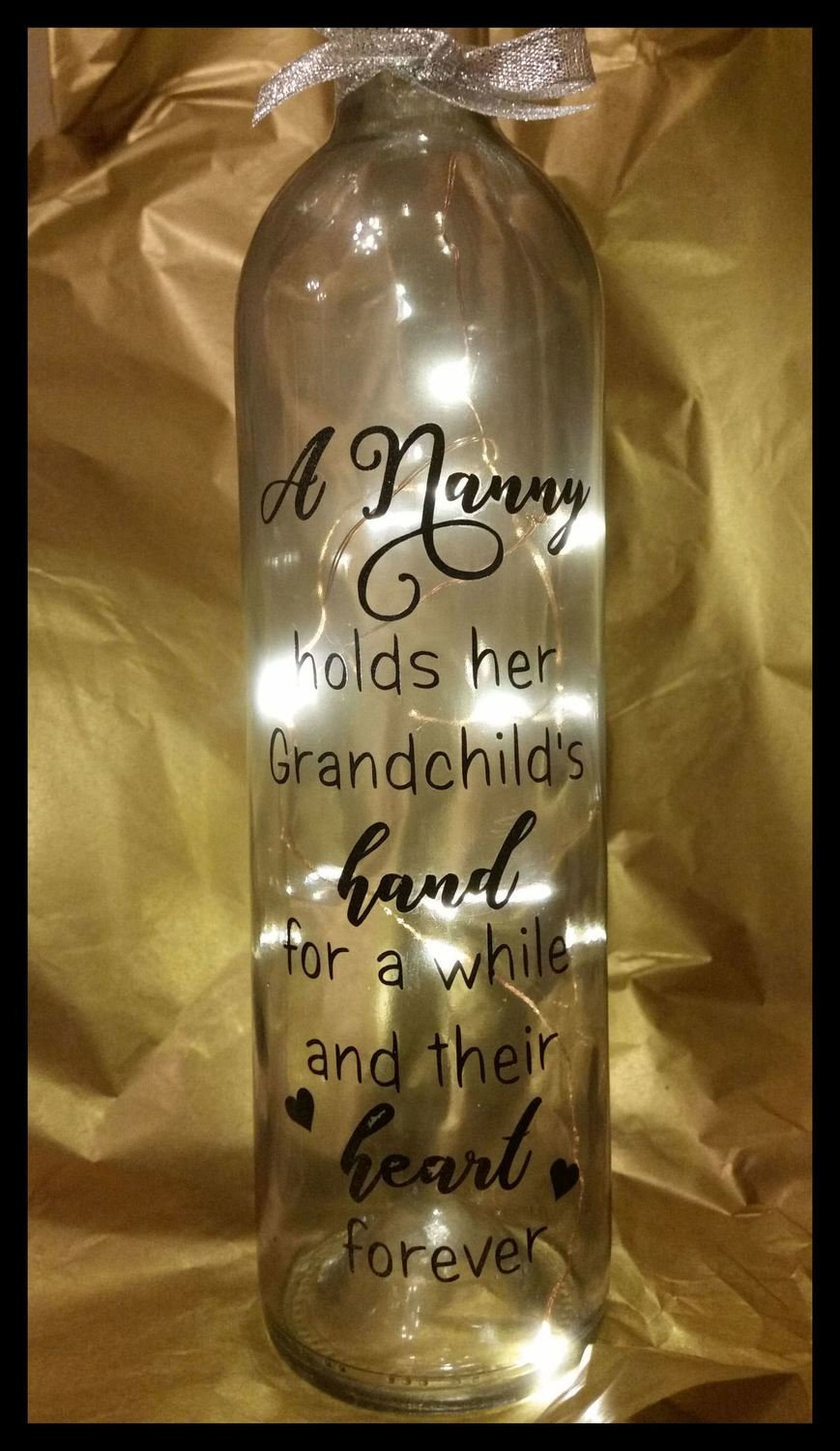 A Nanny hold their Grandchilds Hand for a While Wine Bottle, light block decal.