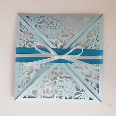 Pastel blue floral laser cut invitation