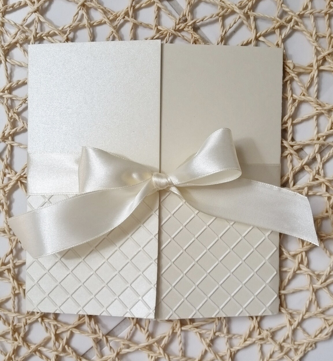 Elegant Embossed Champagne Lattice pattern with ivory Satin Bow and Swarovski Crystals