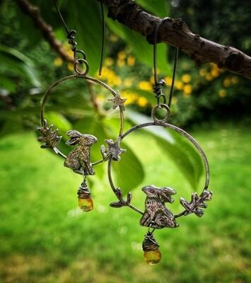 Hare hoop earrings with golden topaz