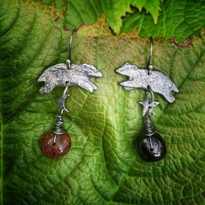 Badger earrings with jet and amber