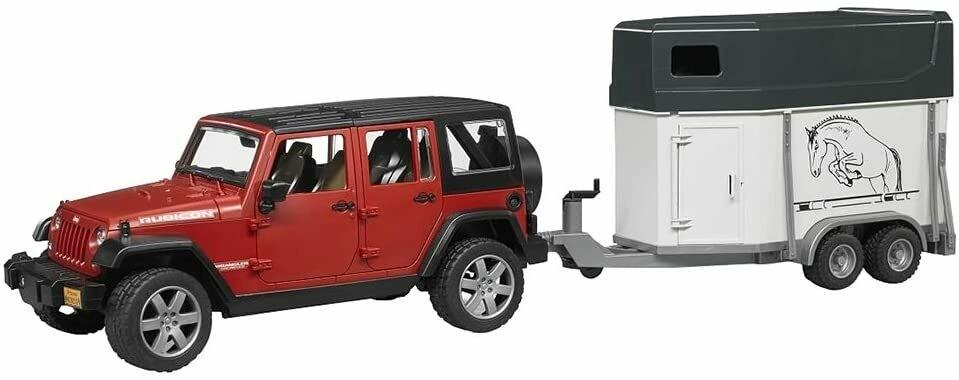 Jeep Wrangler Rubicon rouge avec van et un cheval